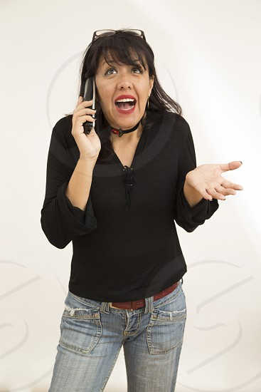 woman with cellphone and hapiness and surprsed attitude photo