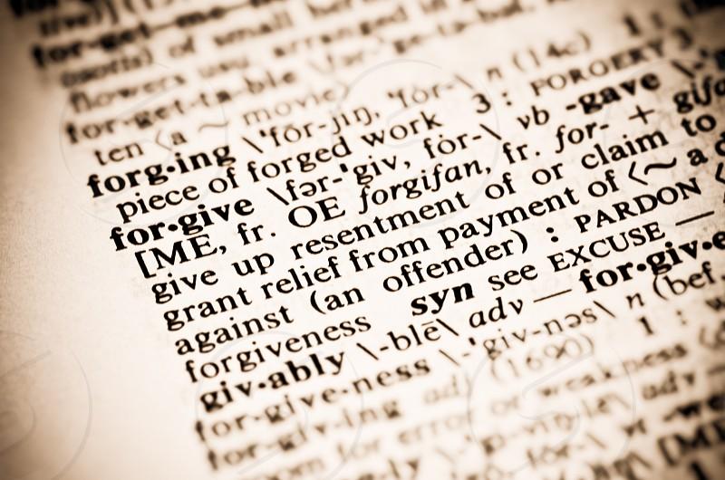 The dictionary definition of forgive.  Macro studio shot. photo