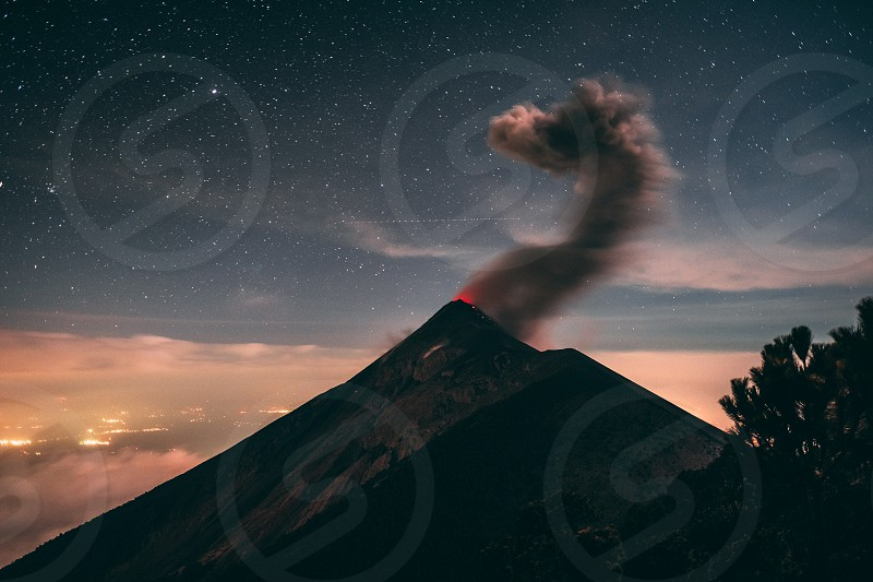 Volcan del Fuego erupting in the night sky in Guatemala. The photo is taken from Volcan Acatenango. photo