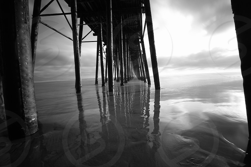 grayscale photo of dock photo
