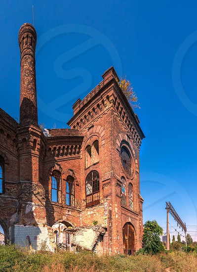 Old abandoned industrial factory Krayan in Odessa Ukraine in a sunny summer day photo