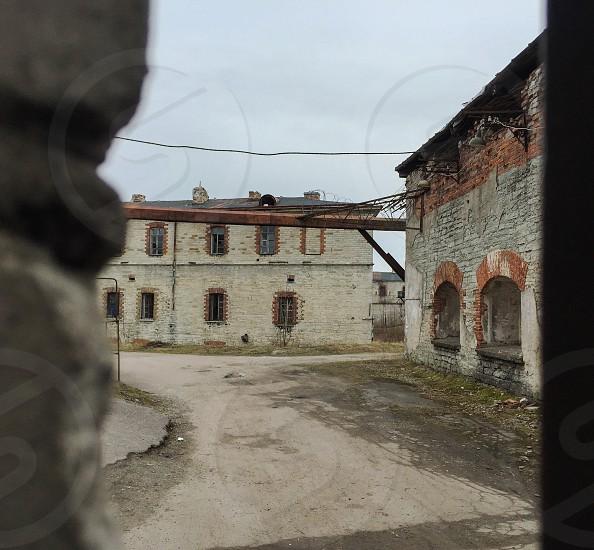Outdoor day horizontal colour square peek view sneak covert prison patarei soviet Baltic architecture incarceration brick Tallinn Estonia Europe European travel photo