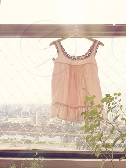 pink dress on white clothes hanger photo