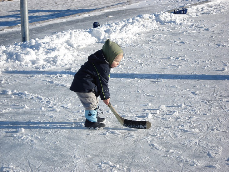 Young boy on ice with hockey stick. photo