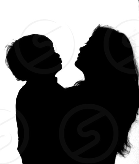 Silhouette of mom and son with detail of lips eyelashes and hair clearly shown. Higher resolution and additional edits available.  photo