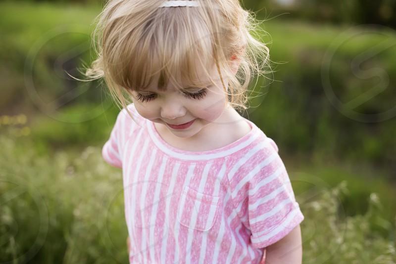 Little girl eyelashes smile summer happy blonde bangs photo