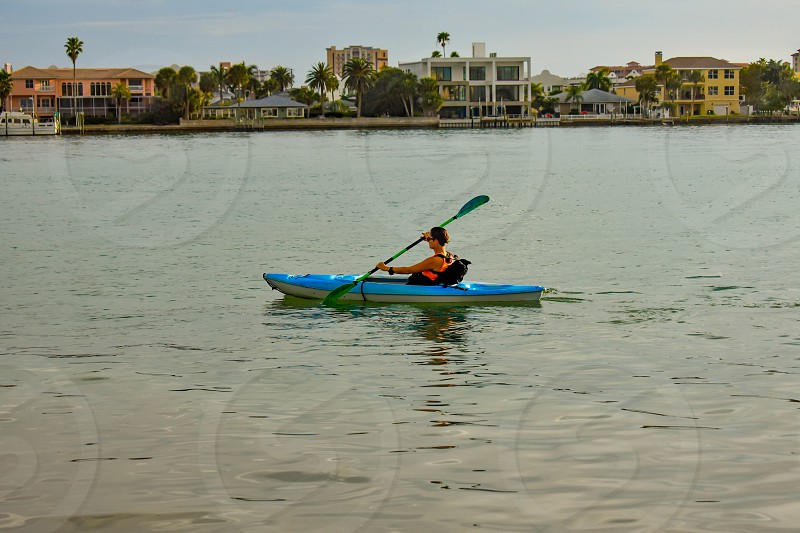 Clearwater Beach Florida. January 25 2019 Woman practice kayaking around the Clearwater Beach. photo