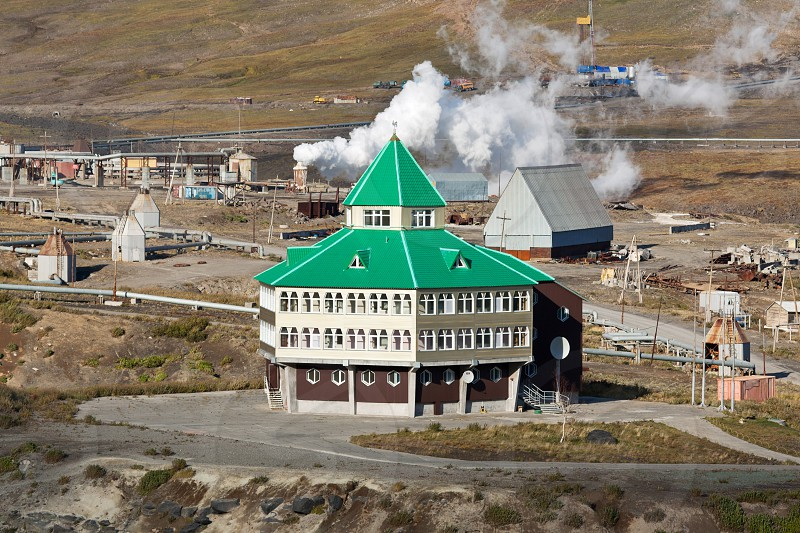 MUTNOVSKY VOLCANO KAMCHATKA PENINSULA RUSSIA - SEP 21 2011: View of hotel building for power plant personnel tourists and travelers located on territory of Mutnovskaya Geothermal Power Station.  photo