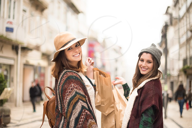 Trendy young women shopping in the city photo