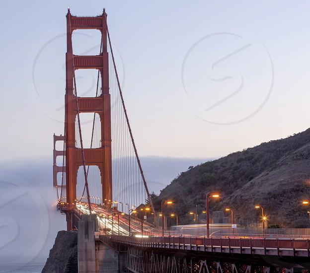 San Francisco Golden gate Bridge with fog and traffic photo