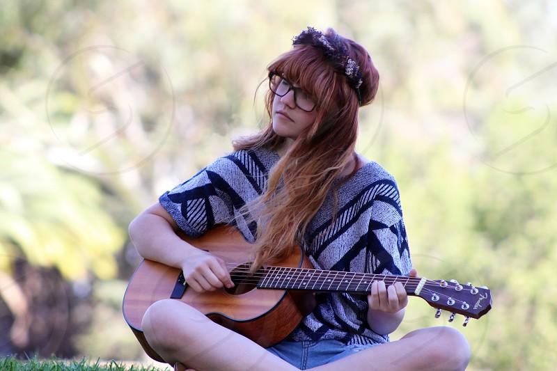 Guitar. Redhead. Outdoors photo