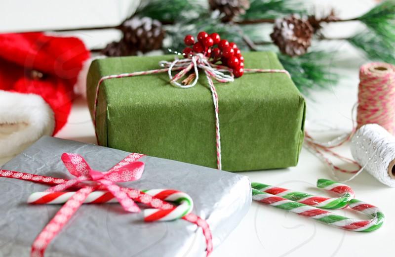 gift boxes near thread spools photo