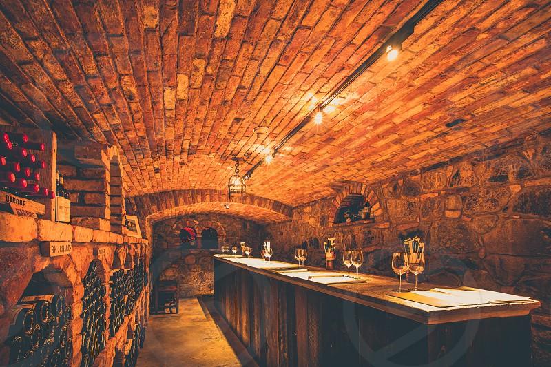 Castello di Amorosa wine tasting castle napa valley winery private room cellar bricks underground light glass bottle calistoga california  photo