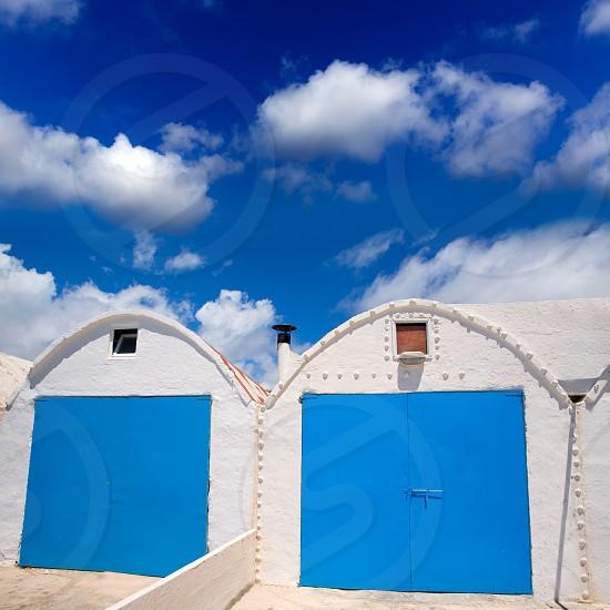 Menorca Punta Prima white Mediterranean beach house facades in Balearic islands photo