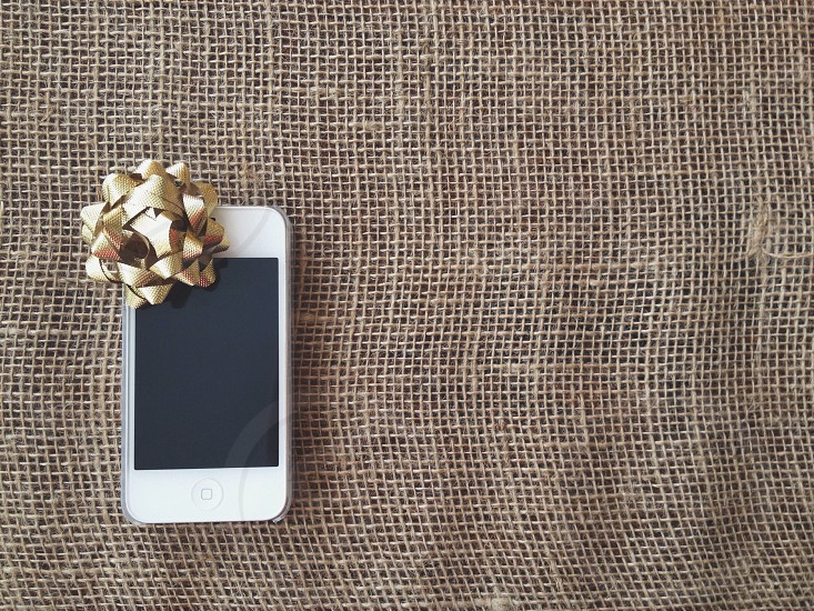 white iphone 4 with fold ribbon photo