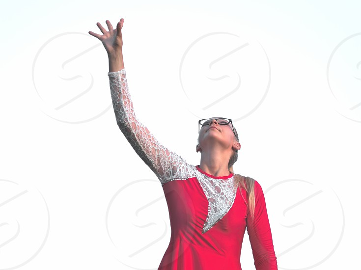 Bespectacled Blonde Teen Majorette Girl in Red Dress Looking Up photo