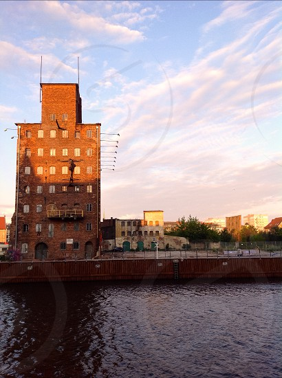 Historical industries building at the river bank in Danzig Poland  photo