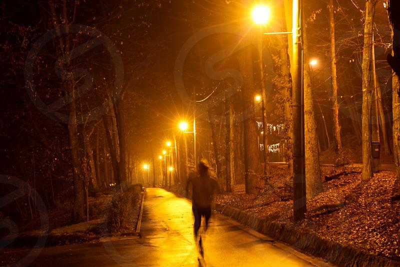man running on concrete pathway photo