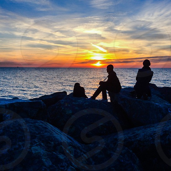 Sunrise and silhouette over Lake Michigan photo