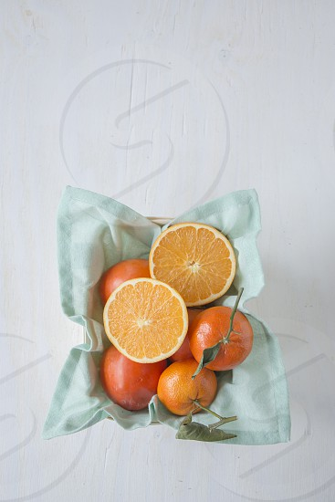 Fresh oranges and clementines photo