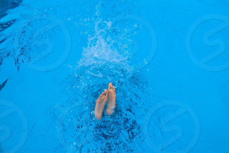 person in swimming pool during daytime photo