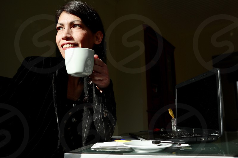 Woman having coffee  photo
