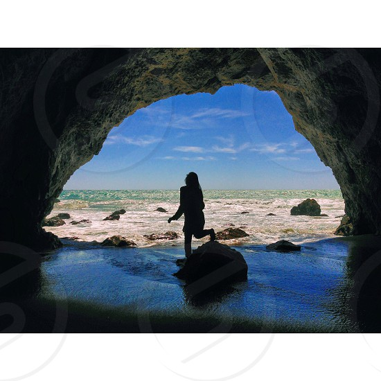 woman coming out of cave photo