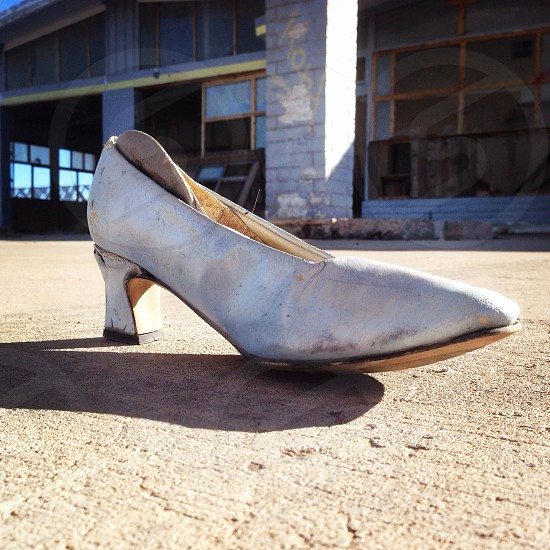 A single high-heeled shoe at an abandoned gas station in Arizona USA. photo