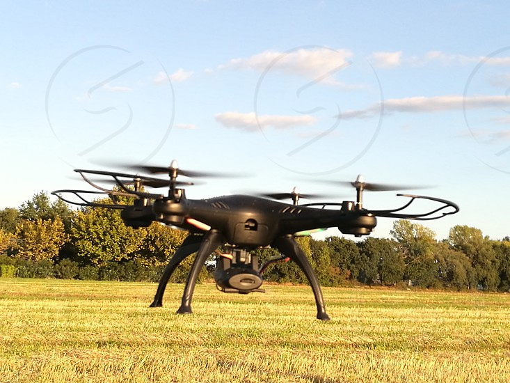 Aerial photography drone on a yellow field photo