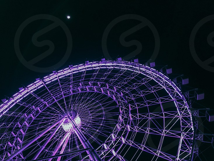 Sky view Ferris wheel purple night moon lights photo