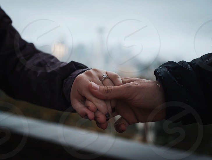 couple in holding hands in close up photo photo