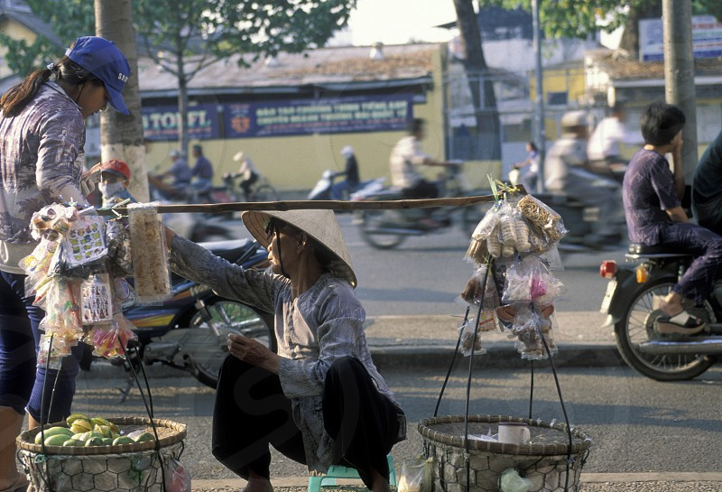 people at a market in the city of ho chi minh city in Vietnam photo
