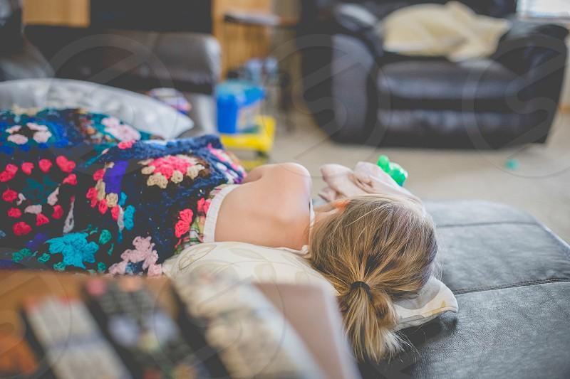 napping child juvenile blanket sleeping girl photo