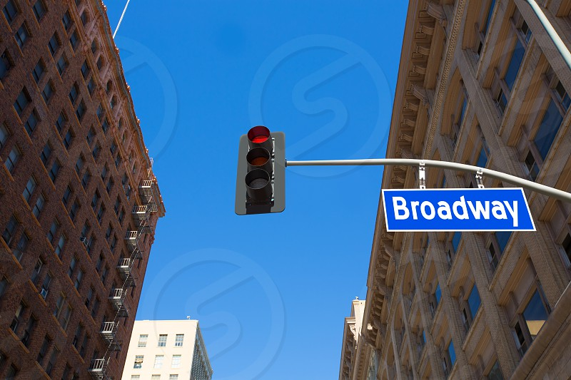 Broadway street Los Angeles Road sign in redlight improved with illustration photo