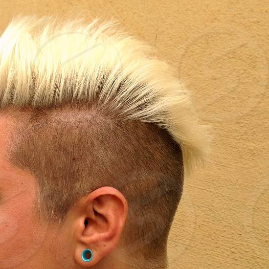 Mohawk bleached blonde hairstyle edgy profile  photo