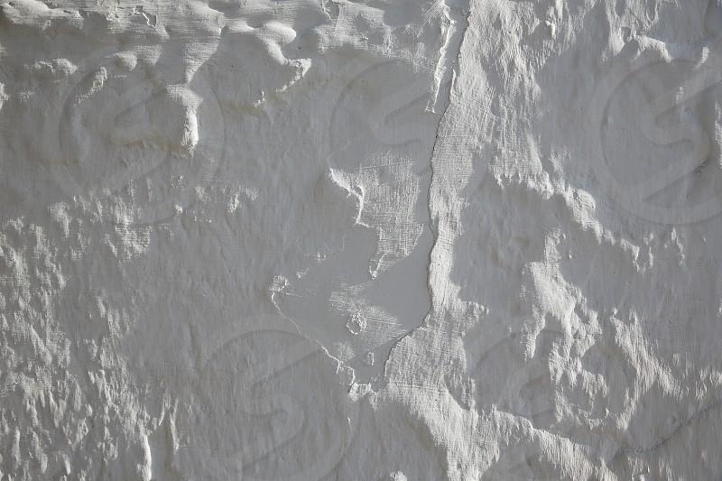 Whitewashed white Mediterranean wall texture in spain photo