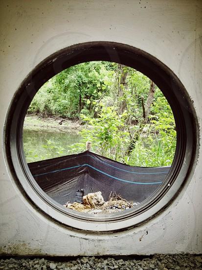 circle concrete hole tarp water creek construction photo