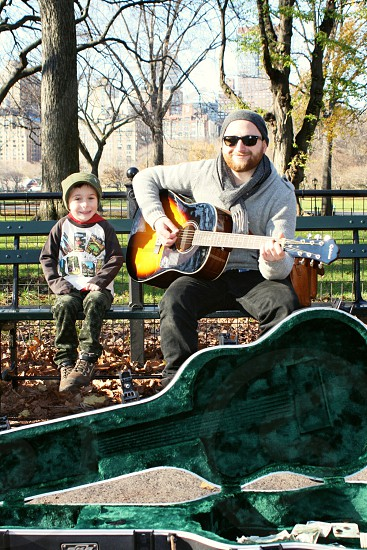 The Mall Central Park NY.  My sweet boy requesting songs and jamming.   photo