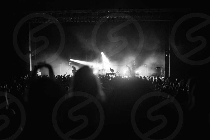 a view of people attending a concert photo