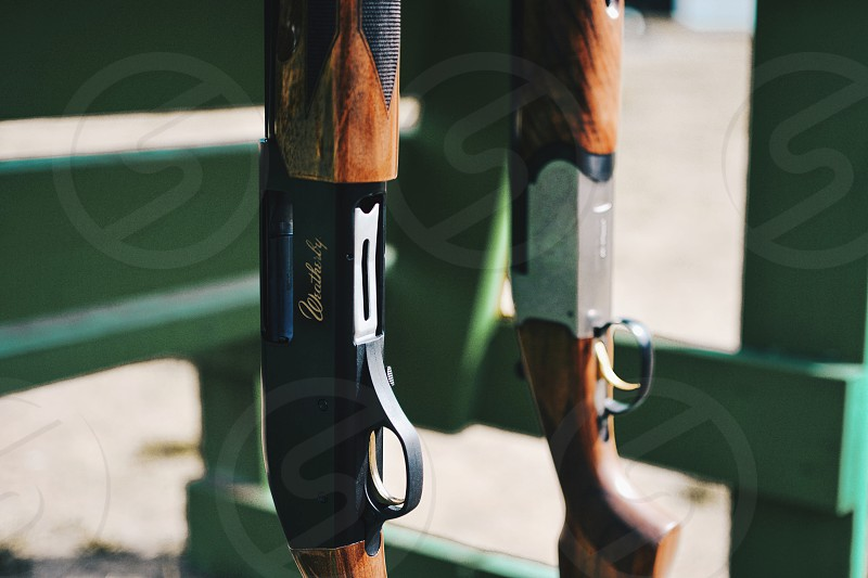 black and brown handle shotgun photo