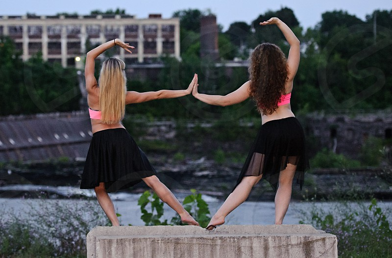 Two female dancers in an urban setting. photo