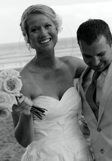 couple in wedding day on beach smiling photo