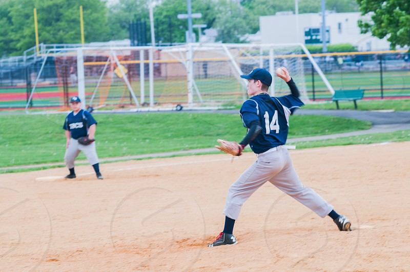 baseball player about to throw ball in the field photo