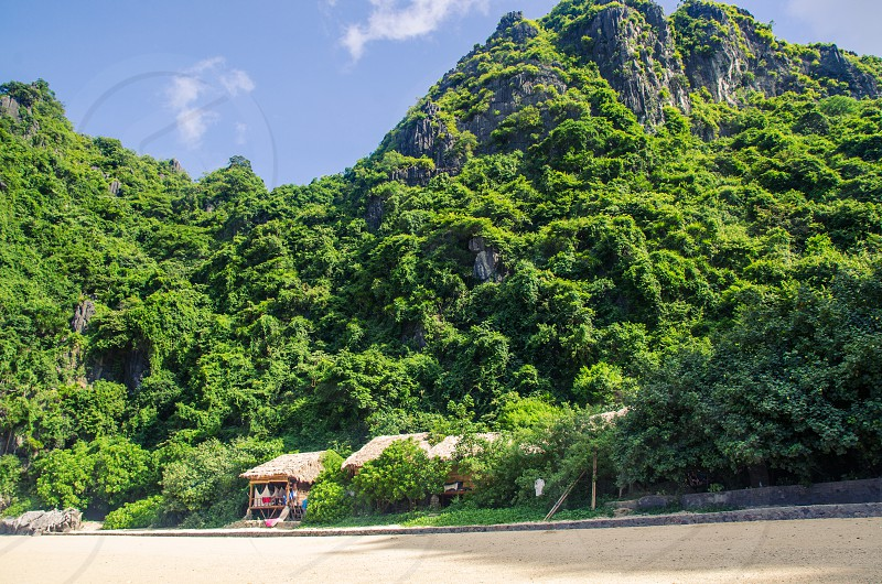 vietnam travel island tropical hut beach private beach hidden secluded ha long bay wanderlust photo