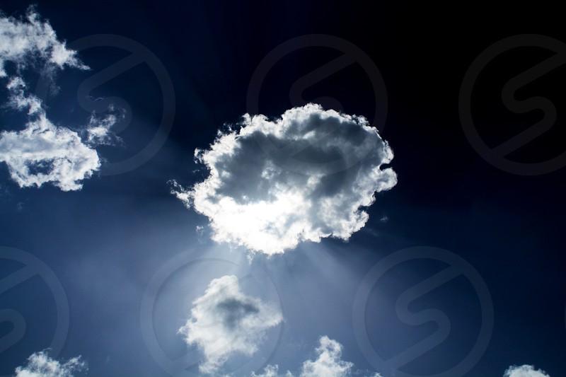 Sunbeams under a cloud photo