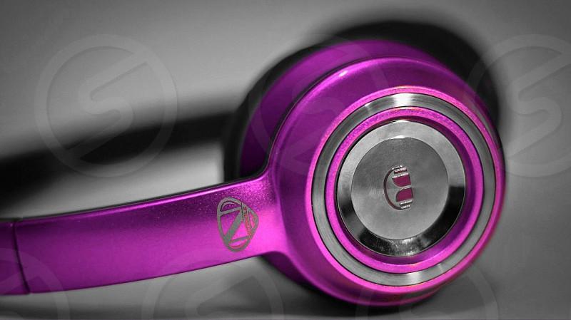 purple headphones in closeup photography photo