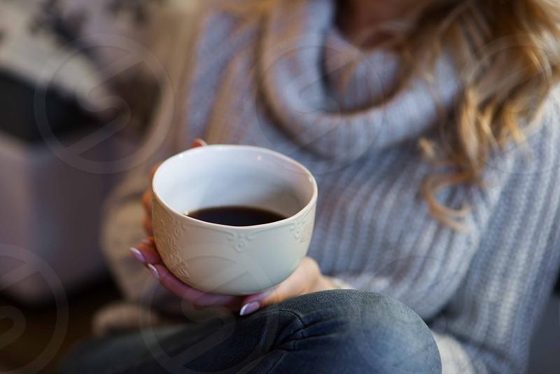 woman drinking coffee in mountain rustic cabin photo