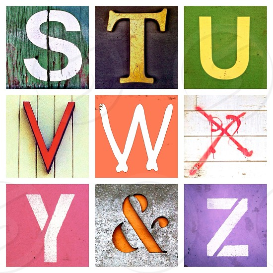 red blue and purple letter prints photo