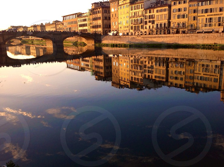 Historical buildings reflections in river Arno in Florence photo