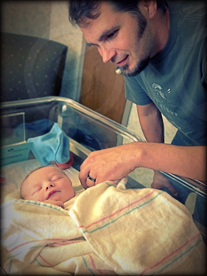 Me looking at my brand new grandson! photo